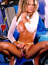 Racquel Darrian covers her magnificent body glistening with oil while sunbathing
