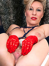 Saffy teases over the phone, then turned on by her kinky girdle and seamed nylon hose, opens up and cums for us.