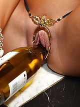 August Ames Inserts Wine Bottle and Distorts Pussy