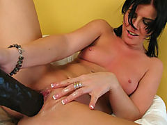 Taryn gapes her cunt with a massive dildo