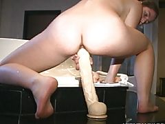Teen With Long Dildo Next To The Jacuzzi