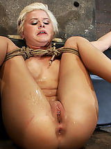 Sexy girl from down under with a cute accent suffers some hard foot caning and one brutal squirting orgasm after another.