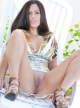 Zoey in heels and a dress with no panties flicks her clit